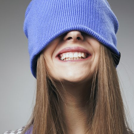 The cheerful girl laughs