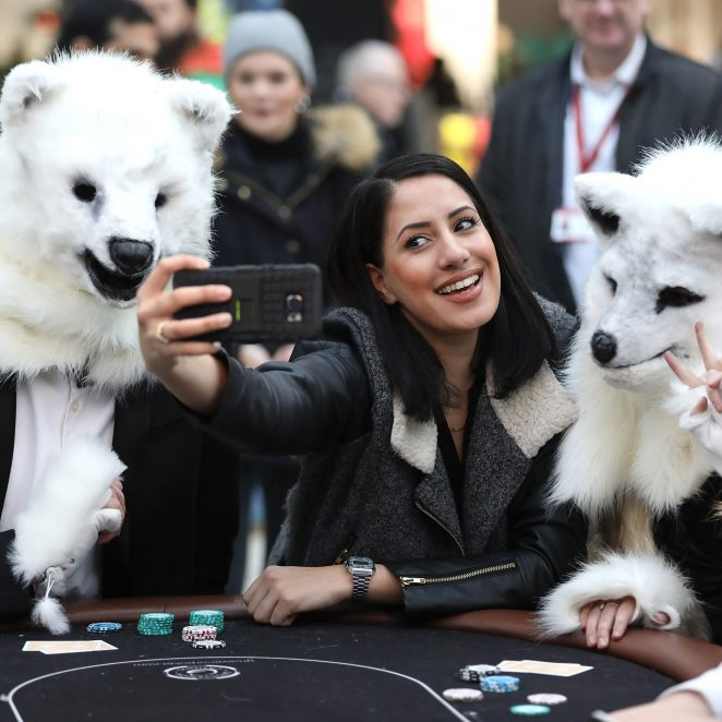 LONDON, ENGLAND - DECEMBER 07:  A commuter takes a selfie as Grosvenor Casinos launches 'Call Of The Wild' Christmas campaign with an inspired re-creation of an iconic image at Waterloo Station on December 7, 2016 in London, England. For more information please contact grosvenor@publicasity.co.uk  (Photo by Tim P. Whitby/Getty Images for Grosvenor Casinos)